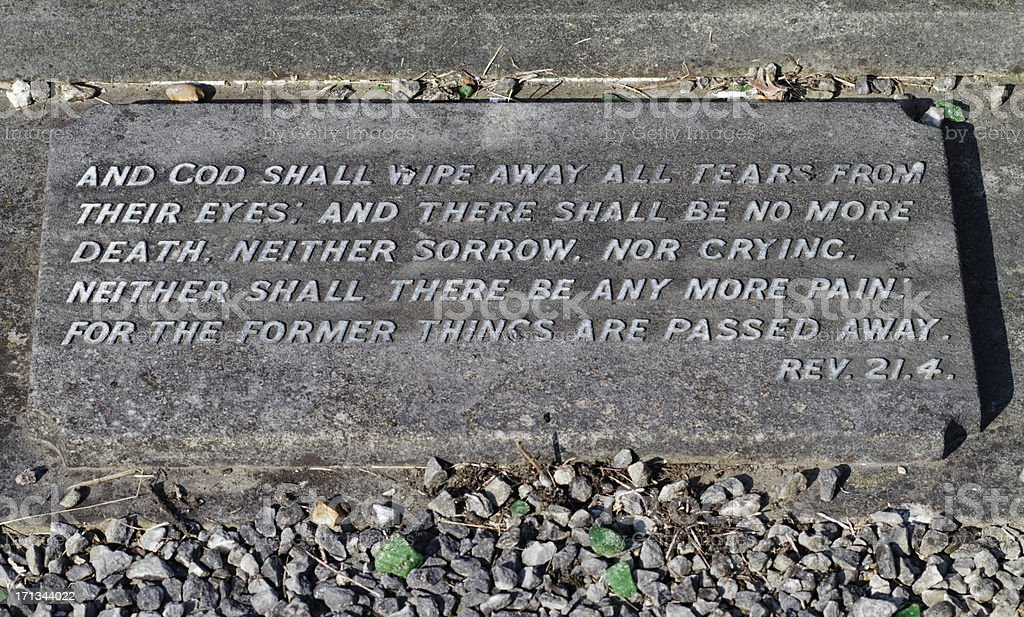 Bible verse on grave Revelations 21.4 stock photo