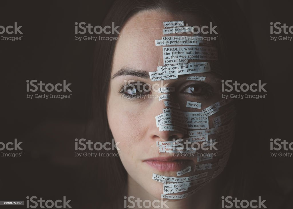 Bible verses on woman's face stock photo