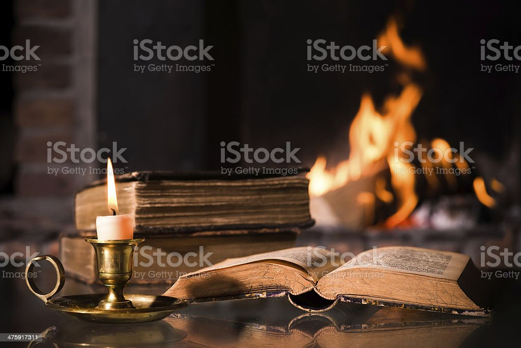 Bible with a burning candle stock photo