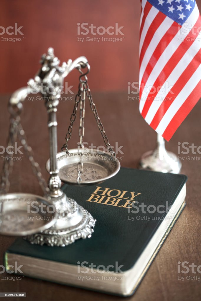 Bible with scale and flag of USA stock photo