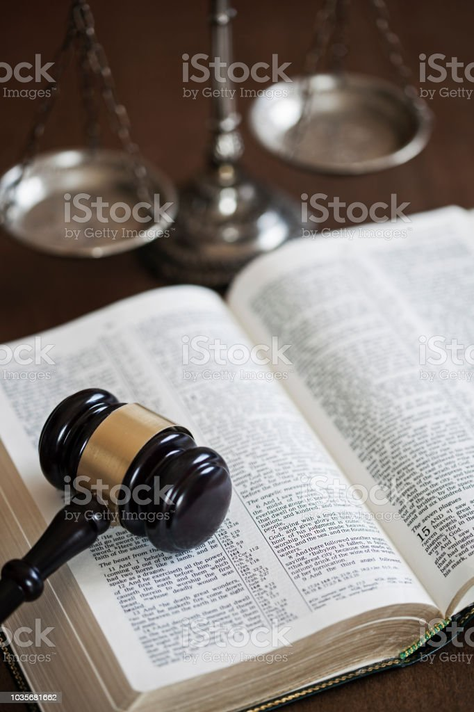 Bible with scale  and gavel stock photo