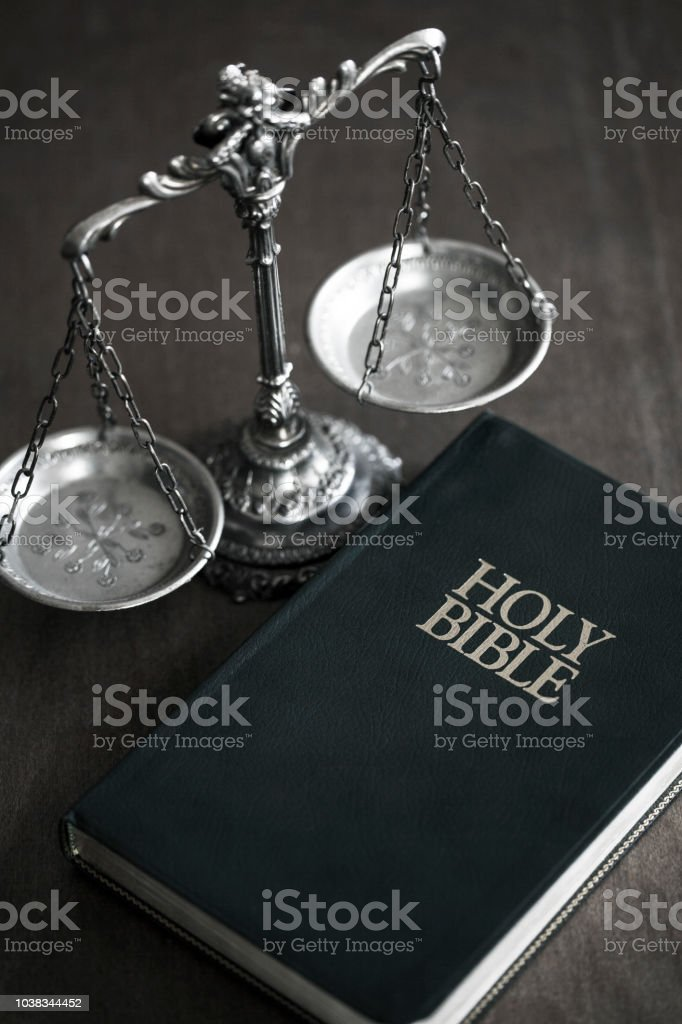 Bible with scale stock photo