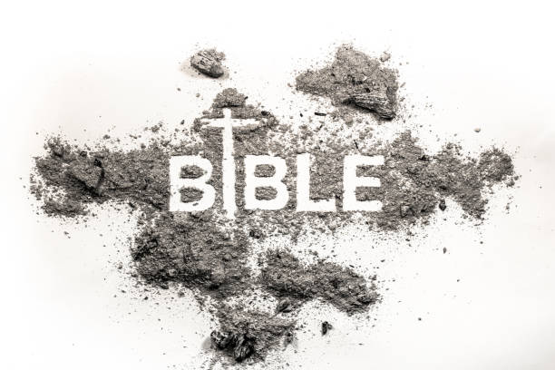 bible word written in grey ash - ash cross stock photos and pictures