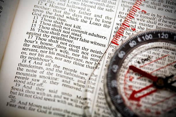 Bible/compass: 10 Commandments stock photo
