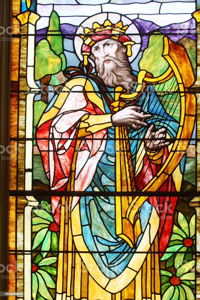 Biblical Harp Player in Stained Glass stock photo