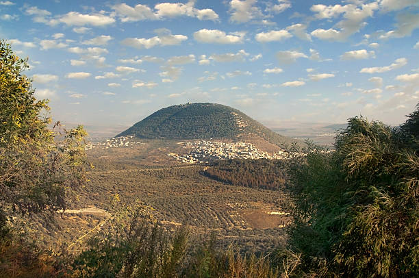 biblical Mount Tavor and the Arab village view of the biblical Mount Tabor and the Arab villages at its foot republic of karelia russia stock pictures, royalty-free photos & images