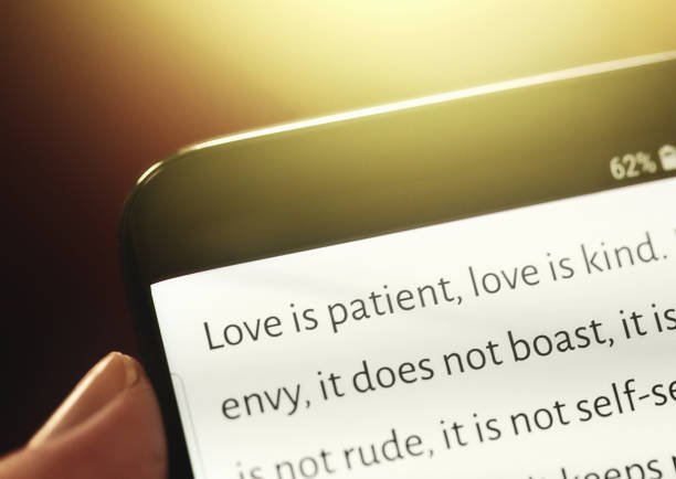 Biblical text message from New Testament displayed on mobile phone stock photo