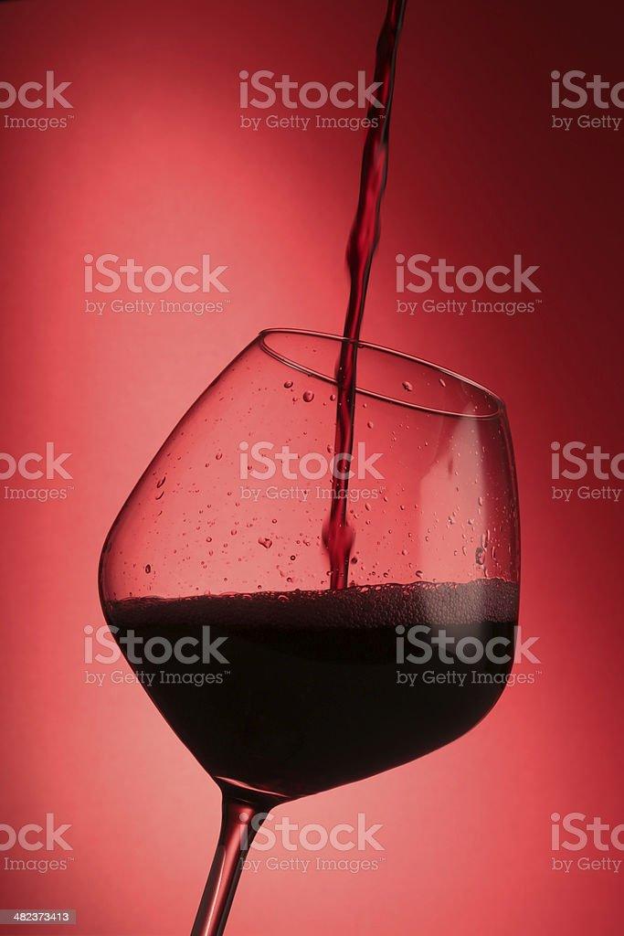 Bicchiere Di Vino Rosso Su Sfondo Rosso Stock Photo Download Image