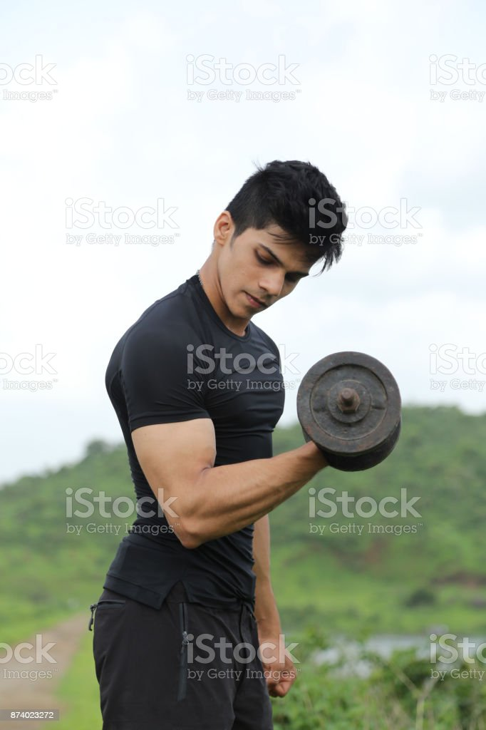 Bicep exercise with dumbbell stock photo