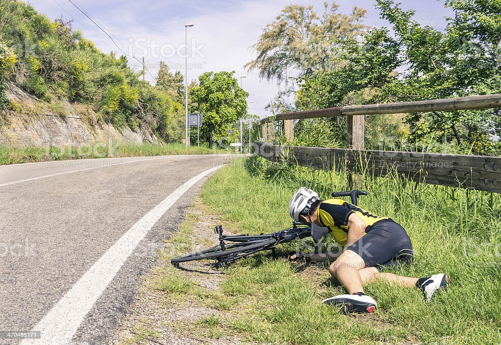 Bicycle accident on the road - Biker in troubles stock photo