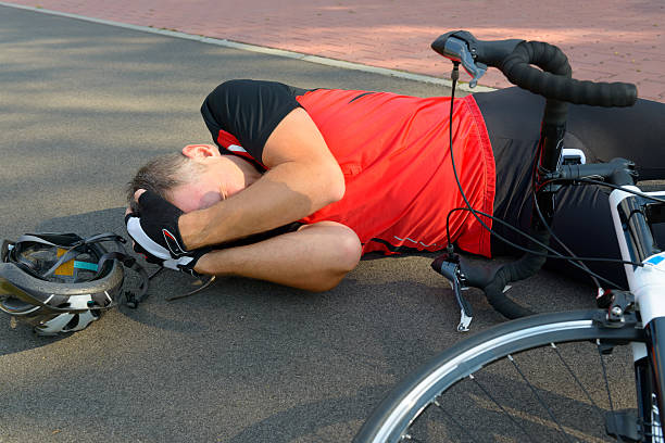 bicycle accident - head injury stock photos and pictures