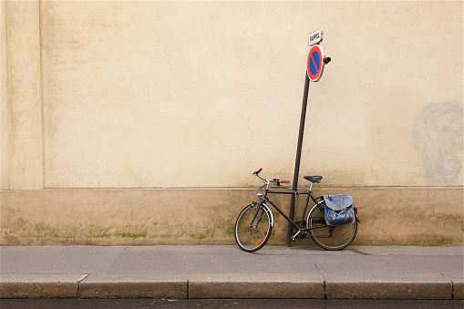 Bicycle against a wall in Paris.
