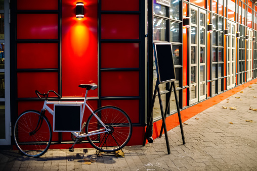 Bicycle against red wall. Space for text messages.