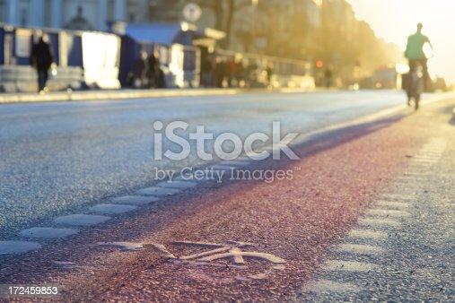 667005568istockphoto Bicycle and bike lane symbol in sunset 172459853