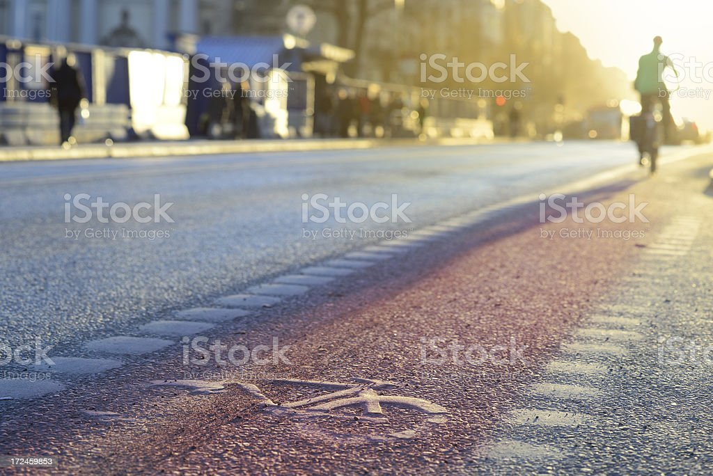 Bicycle and bike lane symbol in sunset stock photo