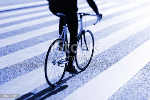 667005568 istock photo Bicycle and zebra crossing 180714321