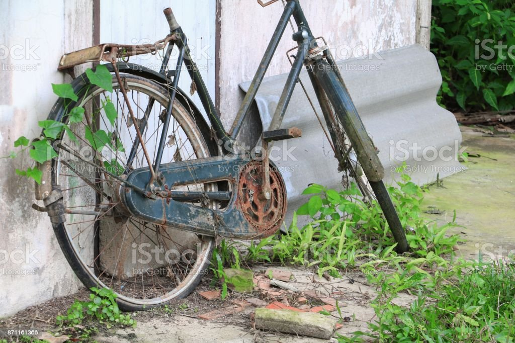 bicycle Antique Broken Old at decay and rust stock photo