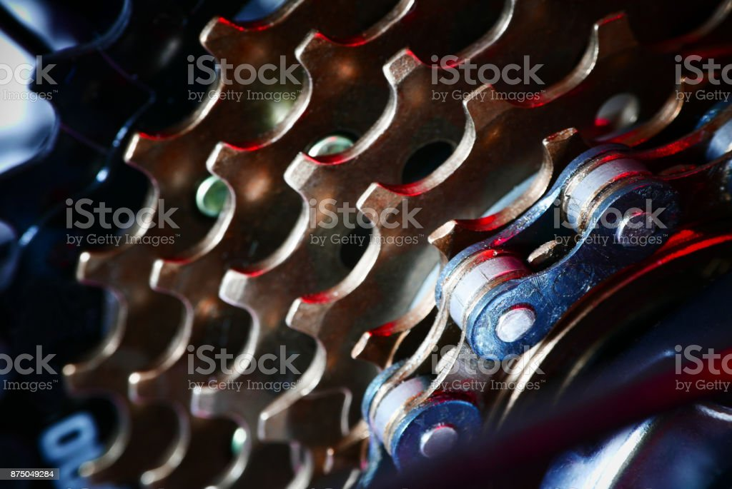 Bicycle chain background with red light stock photo