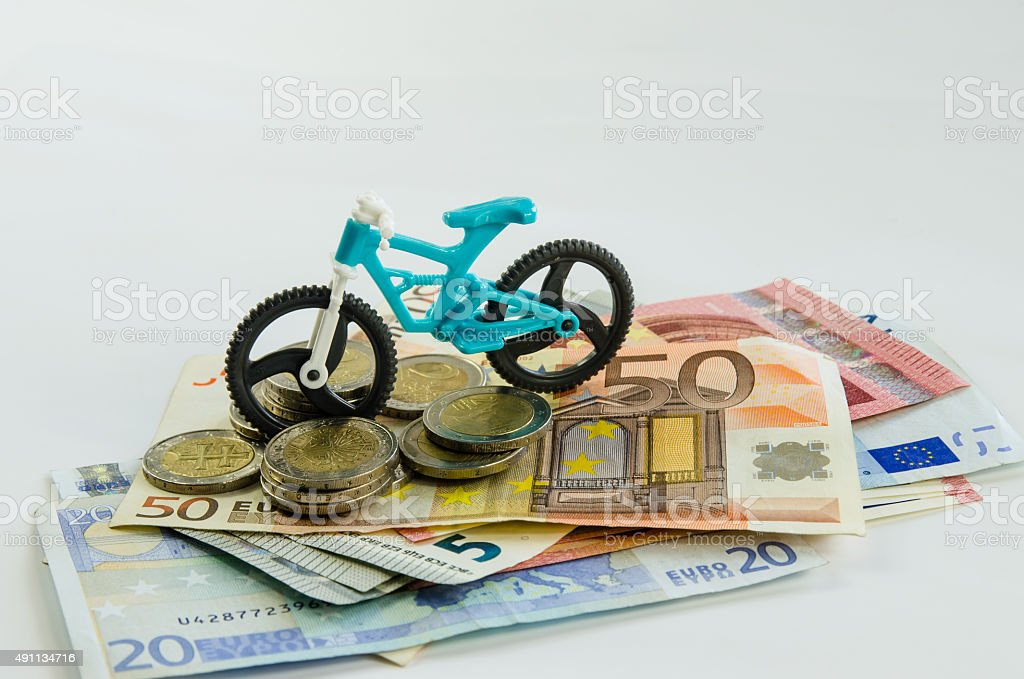bicycle, coins and banknotes stock photo