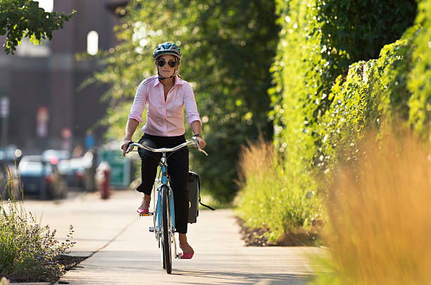 Bicycle Commuter in The City Riding Home From Work.