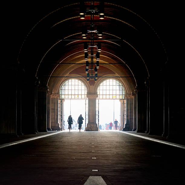 Bicycle corridor under the Rijksmuseum Amsterdam, the Netherlands - March 12, 2014: Bicycle corridor under the Rijksmuseum. It's a cycle path to the museumplein in Amsterdam. rijksmuseum stock pictures, royalty-free photos & images