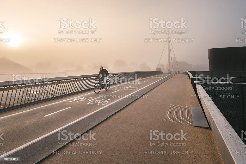 Bicycle crossing the bridge stock photo