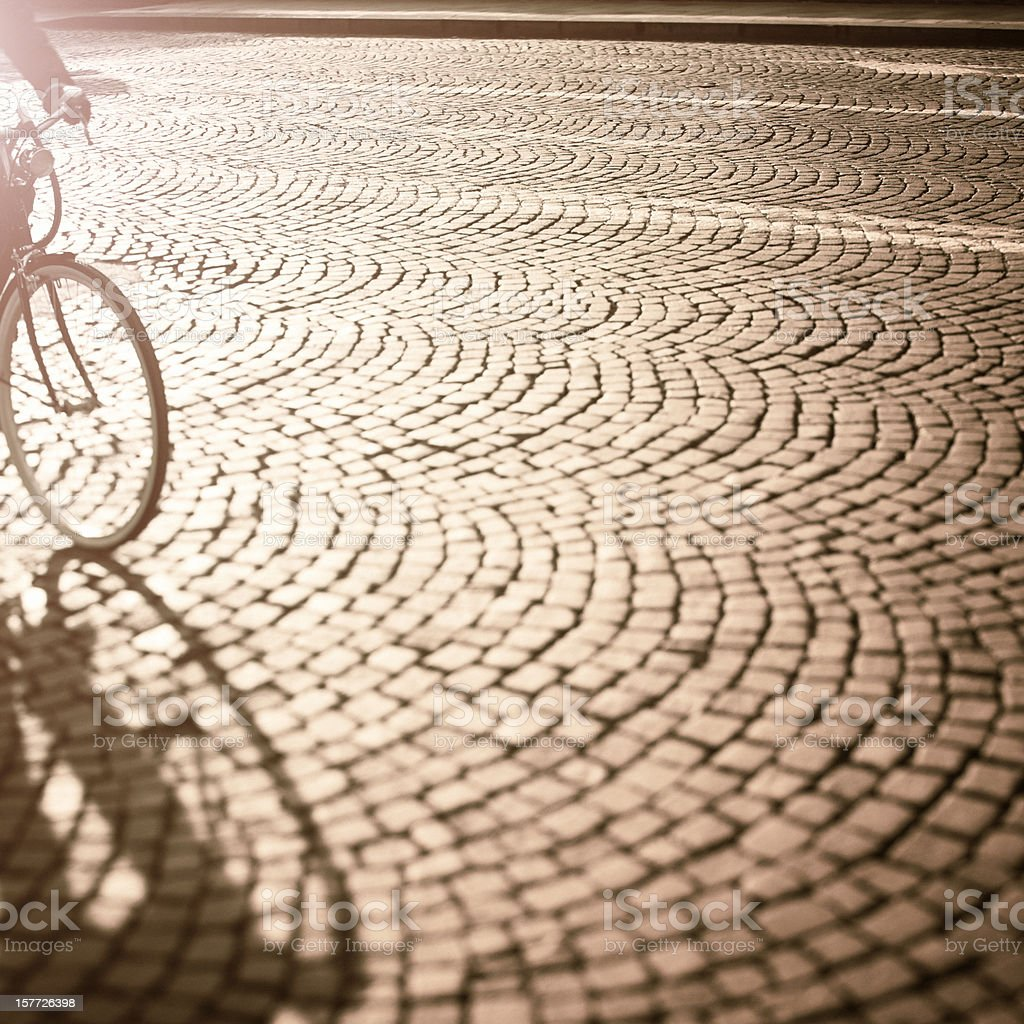 Bicycle Cycling at Sunset, Cobblestones Background, Tilt Shift royalty-free stock photo