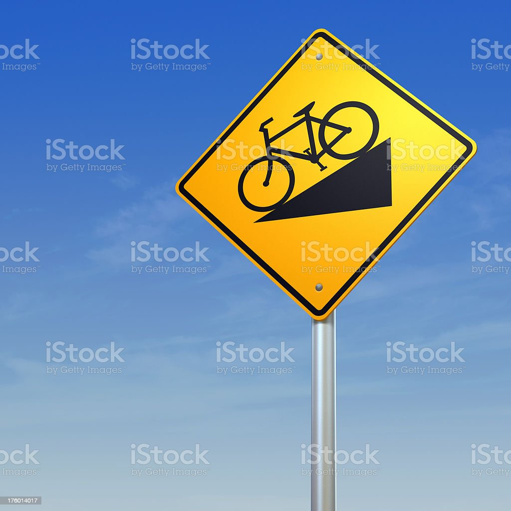 bicycle downhill -  yellow warning road sign stock photo