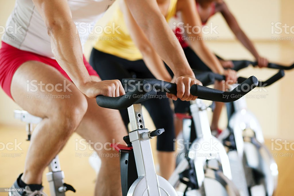 Bicycle Spinning in gym stock photo