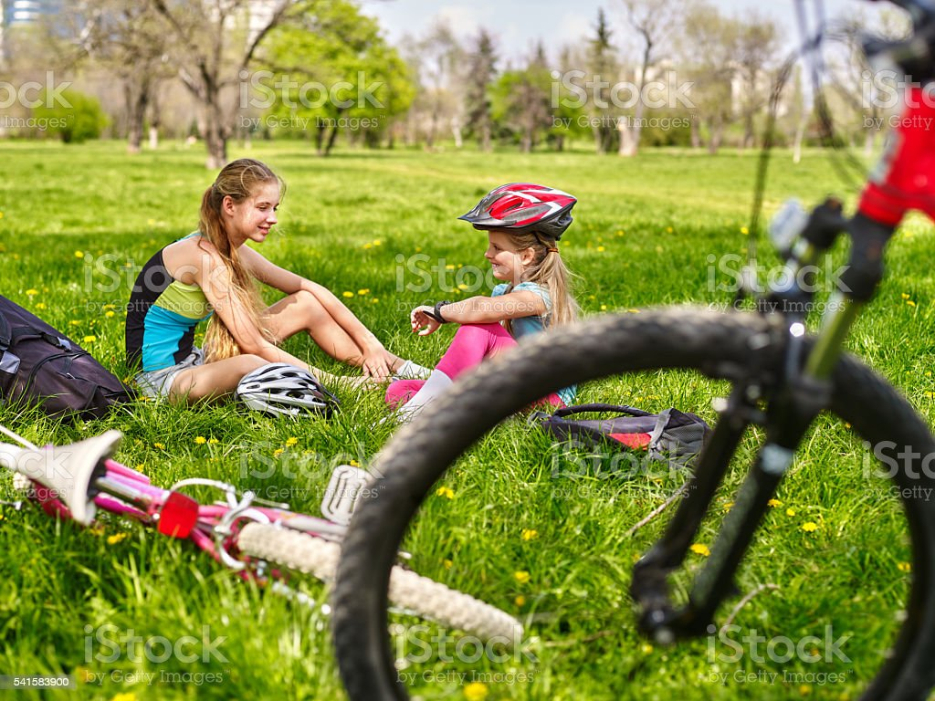 Bicycle girls wearing helmet. They have rest from cycling. stock photo