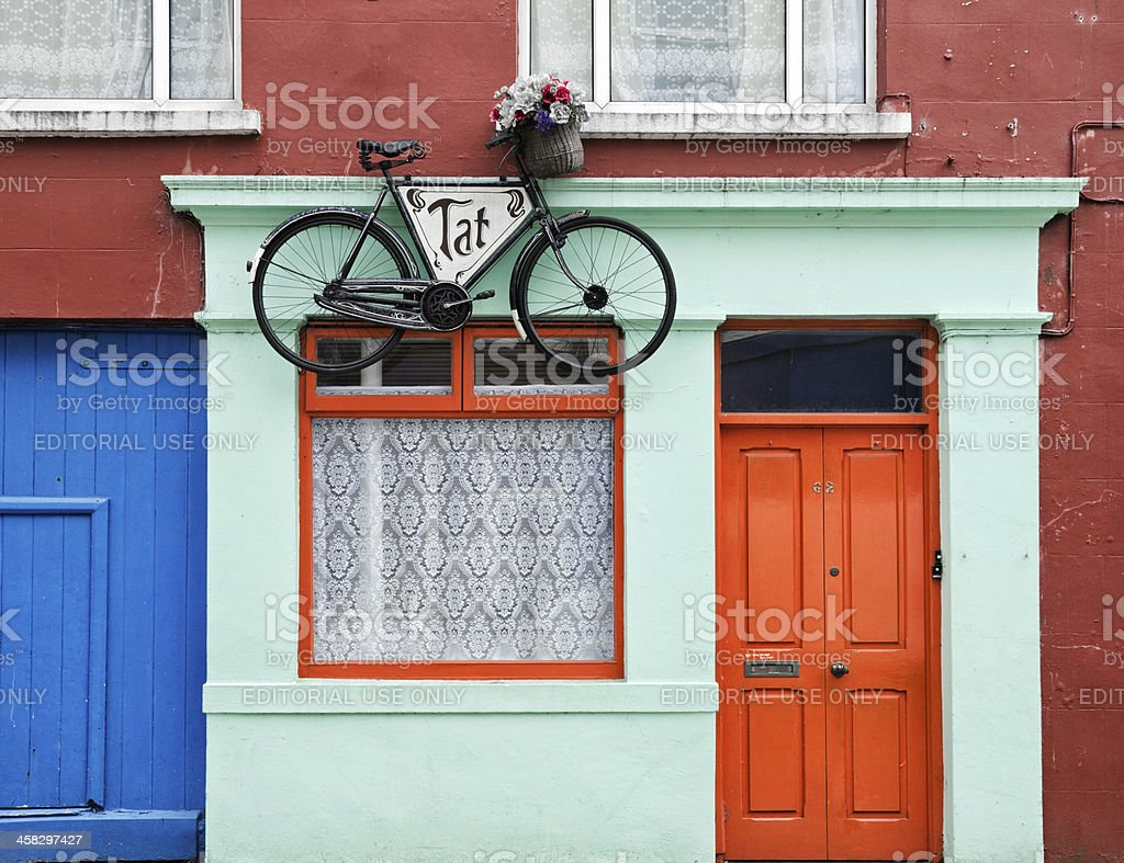 Bicycle hanging from building in Skibbereen, Ireland royalty-free stock photo