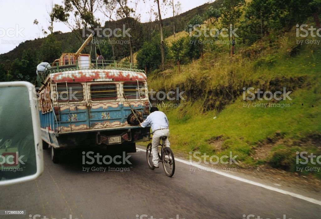 bicycle hitch hiking behind a typical bus on a road (colombia royalty-free stock photo