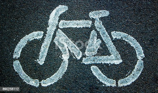 istock Bicycle icon background texture with some fine grain 890258112