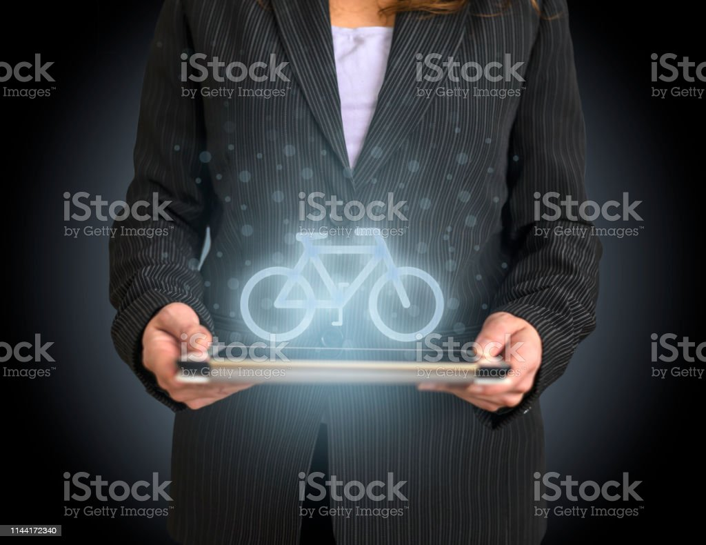 Bicycle icon concept on tablet with hologram stock photo