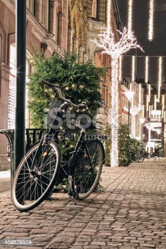 istock Bicycle in Christmas decorated street 459526529
