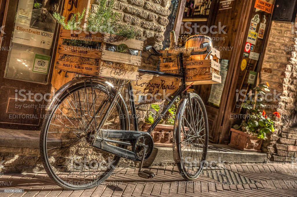 Bicycle in front of a San Gimignano restaurant, Italy stock photo