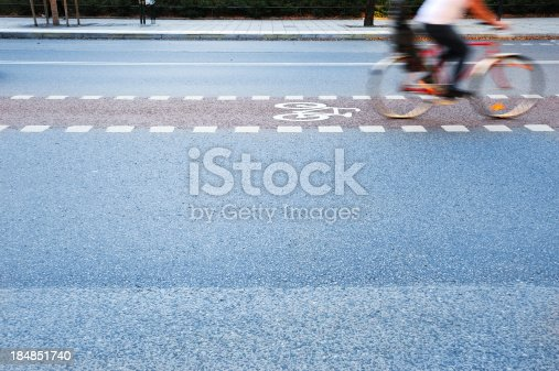 863454090 istock photo Bicycle in motion, bike lane, profile 184851740