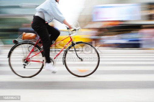 863454090 istock photo Bicycle in motion on zebra crossing 168396473