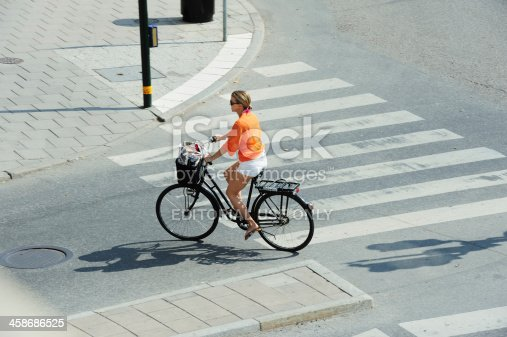 863454090 istock photo Bicycle in motion on zebra crossing 458686525