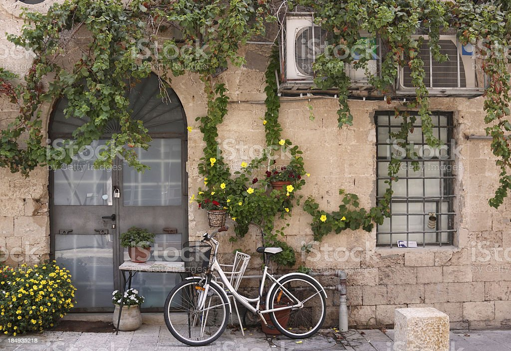 """Bicycle in Old Jaffa """"White bicycle parked in front of typical old house in Old Jaffa, Tel Aviv, Israel. More images from Israel:"""" Ancient Stock Photo"""