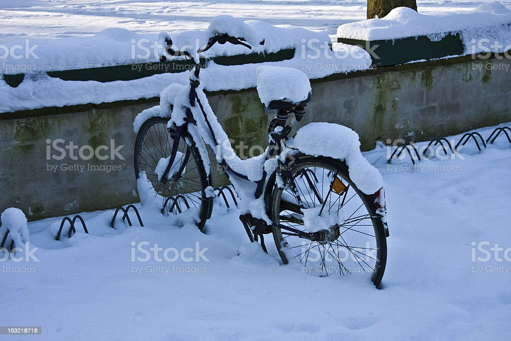 Bicycle in the snow forgotten royalty-free stock photo