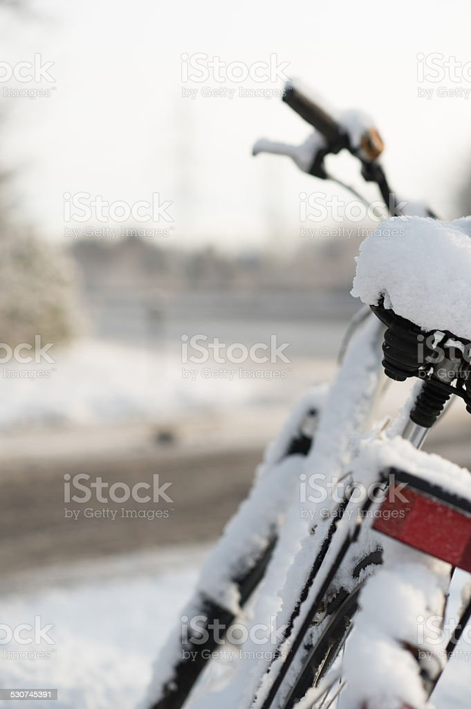 Bicycle in the snow stock photo