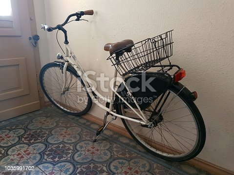 812812808istockphoto Bicycle in the Staircase 1035991702