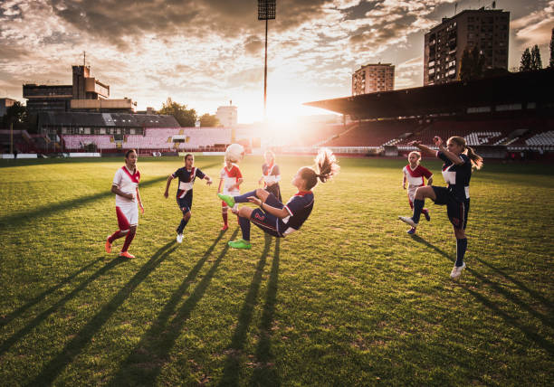bicycle kick on a soccer match at sunset! - soccer competition stock photos and pictures