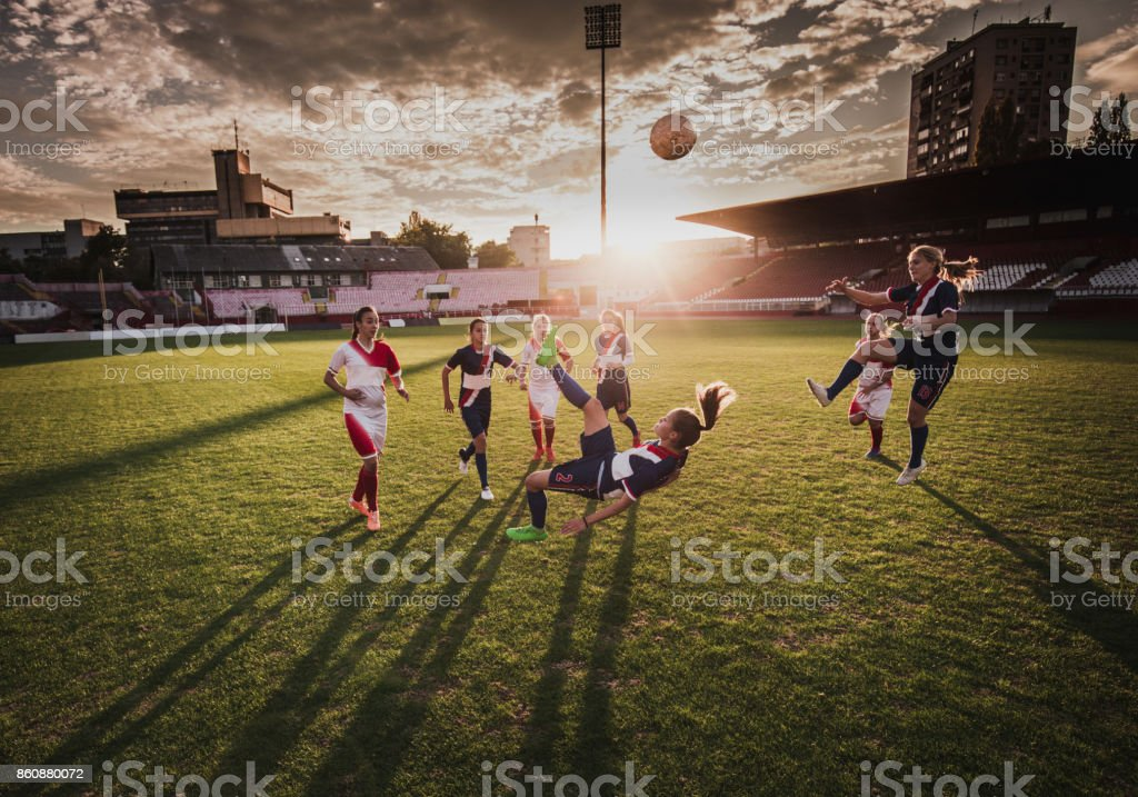 Bicycle kick on a soccer match at sunset! stock photo