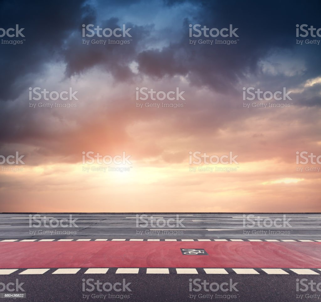 bicycle lane and dramatic sunset sky stock photo