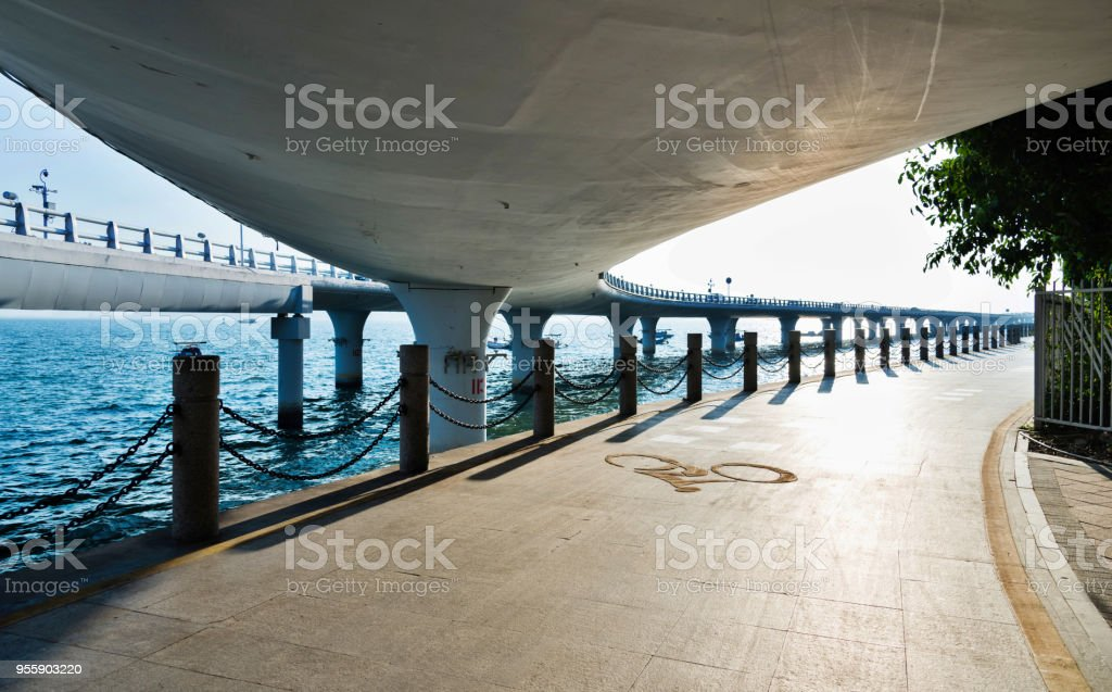 Bicycle lane and viaduct by the sea stock photo
