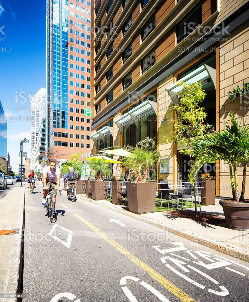 Bicycle lane in downtown Montreal on a sunny Summer day stock photo