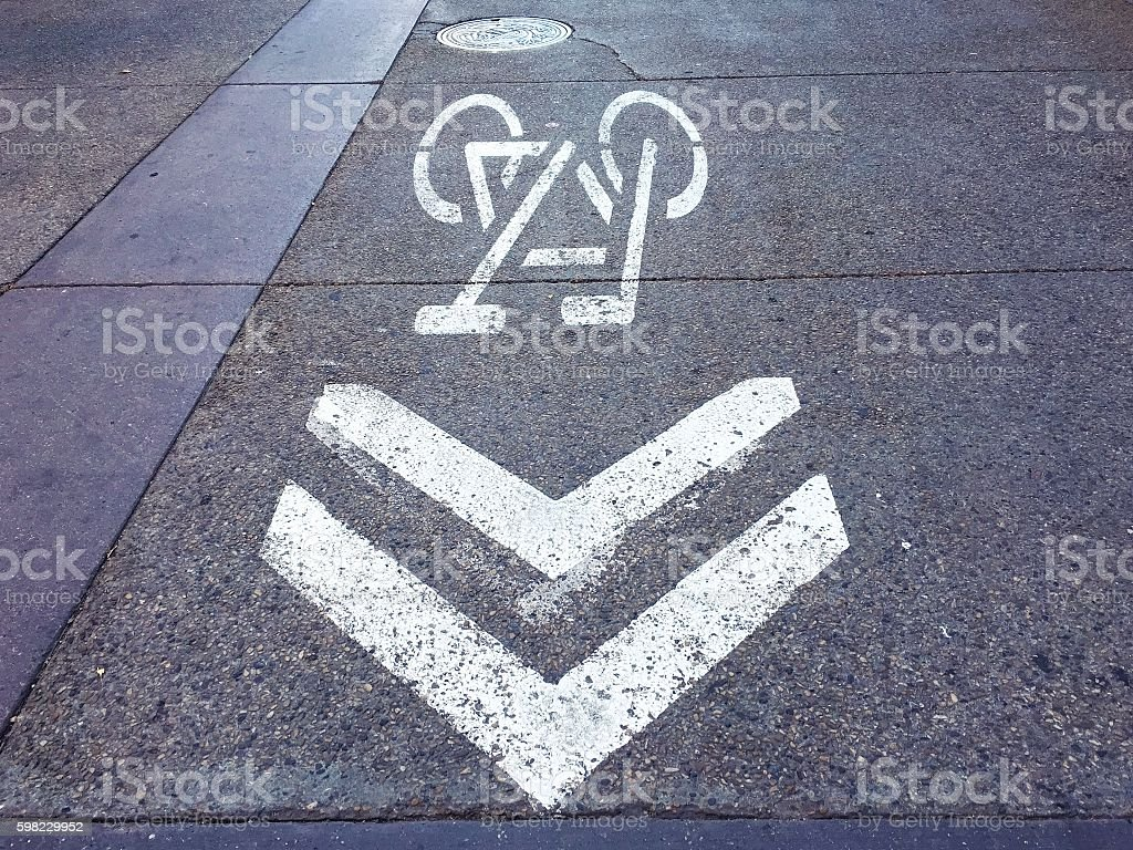 Bicycle lane painted on street in resident area foto royalty-free
