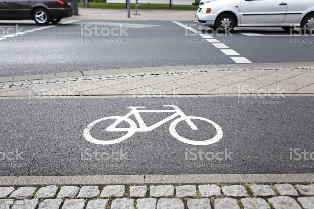 Bicycle lane - passing car royalty-free stock photo